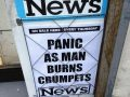 The front page of a Staines News newspaper displaying the headline: PANIC AS MAN BURNS CRUMPETS.