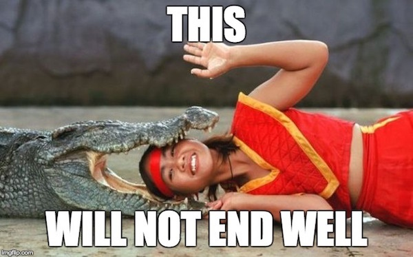An image of a young women with a red headband lying with her head in the jaws of an alligator. The image has a meme-style caption, which reads: THIS WILL NOT END WELL.